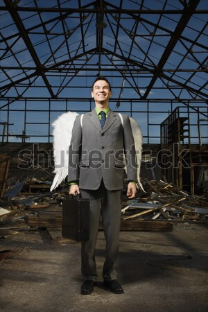 Young Businessman Standing on Stairs Stock photo © iofoto