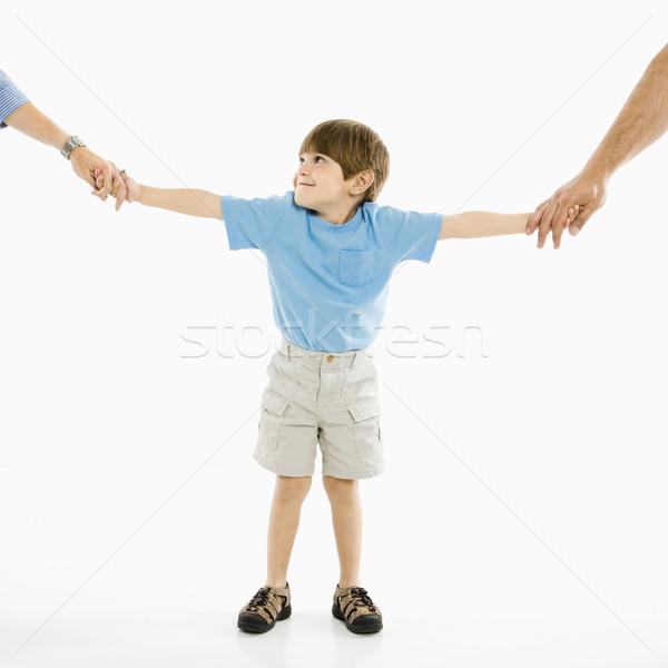 Garçon parents mains tenant permanent blanche famille Photo stock © iofoto
