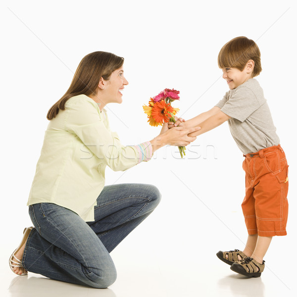 Son giving mother flowers. Stock photo © iofoto