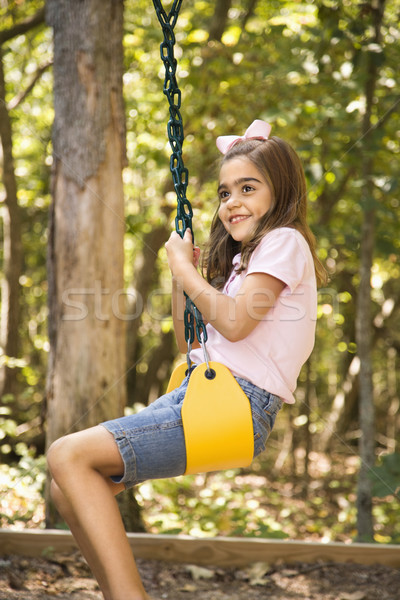 Girl swinging. Stock photo © iofoto