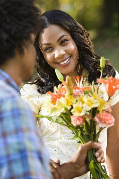 Woman getting flowers. Stock photo © iofoto