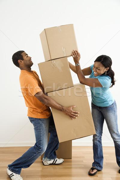 Pár költözködő dobozok afroamerikai női dobozok nagy Stock fotó © iofoto