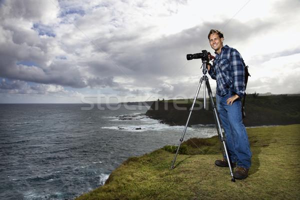 Man photographing scenery. Stock photo © iofoto
