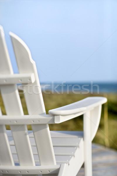 Adirondack chairs pointing toward ocean. Stock photo © iofoto