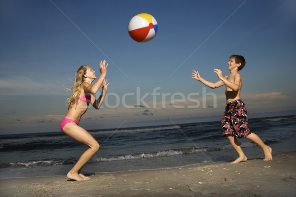 Stock photo: Boy and girl on beach.