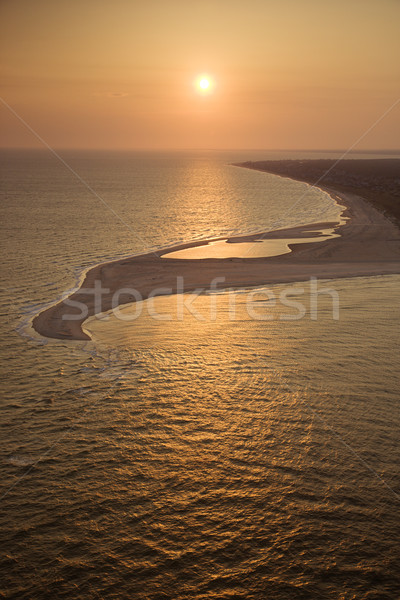 Stock photo: Beach at sunset.