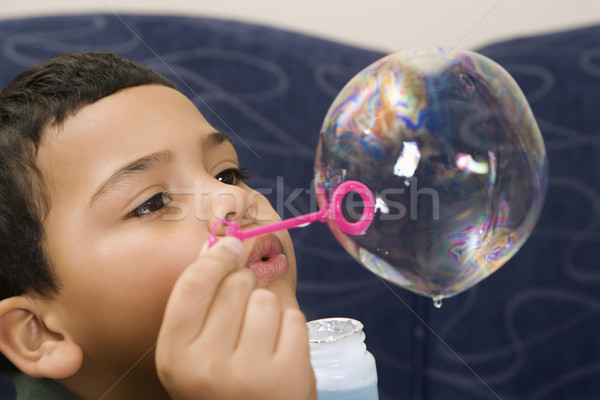 Boy blowing bubble. Stock photo © iofoto