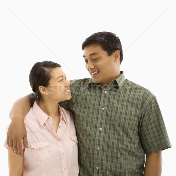 Mid adult Asian couple. Stock photo © iofoto