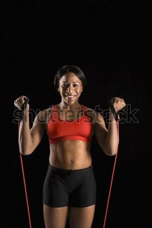 Woman with resistance tube. Stock photo © iofoto