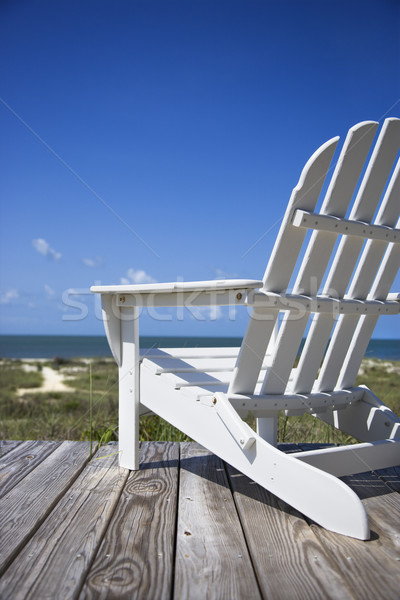 Chair on beach deck. Stock photo © iofoto