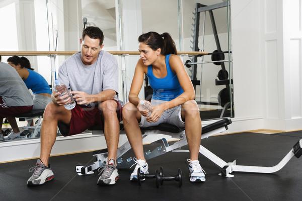 Pessoas ginásio homem mulher sessão exercer Foto stock © iofoto