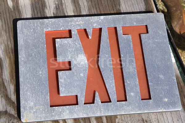 Exit sign on wood Stock photo © iofoto