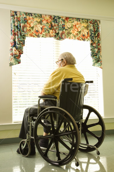 Elderly Man in Wheelchair by Window Stock photo © iofoto