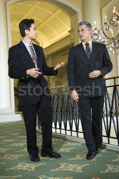 Two businessmen in hotel. Stock photo © iofoto