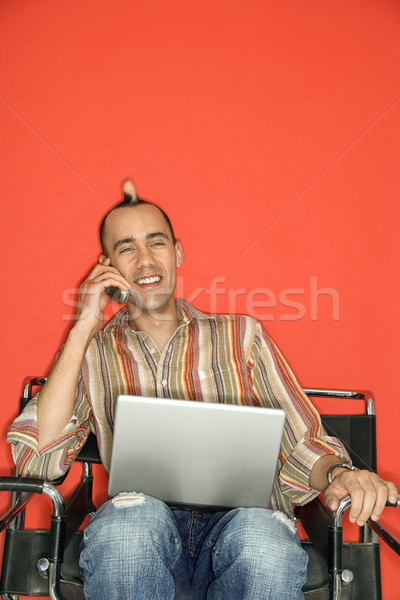 Man with laptop and cellphone. Stock photo © iofoto