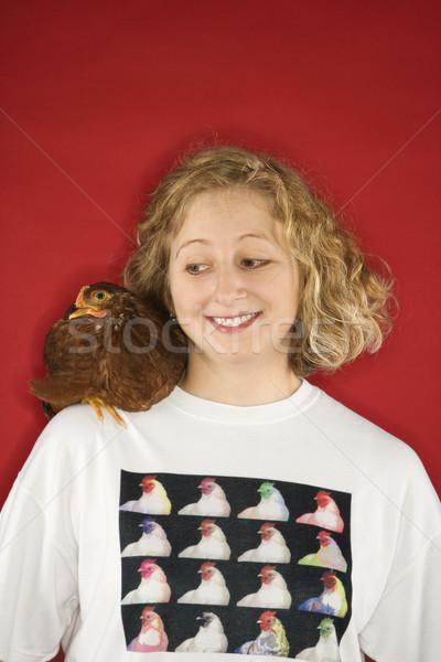 Mulher frango ombro caucasiano olhando sorrir Foto stock © iofoto