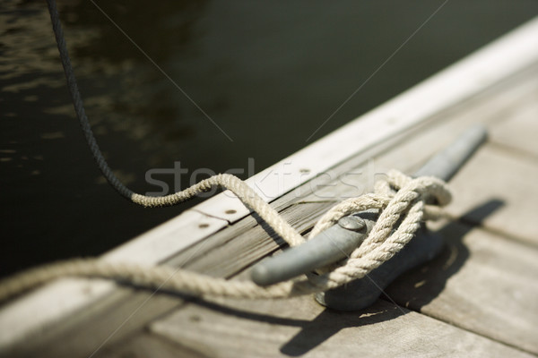 Rope tied to boat dock. Stock photo © iofoto