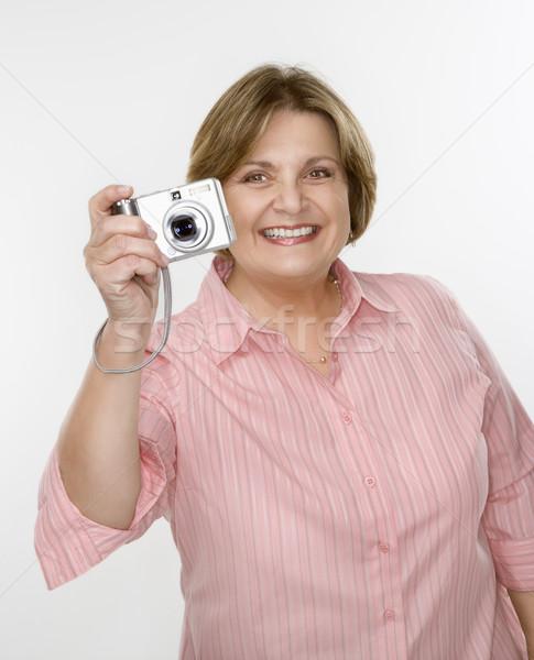Woman taking picture. Stock photo © iofoto