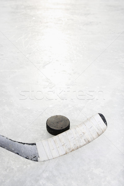 Stock photo: Hockey stick and puck.