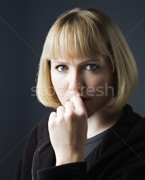 Pensive young woman Stock photo © iofoto