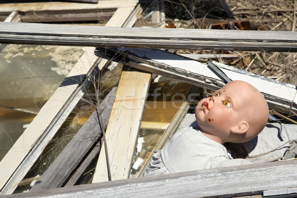 Old abandoned baby doll. Stock photo © iofoto