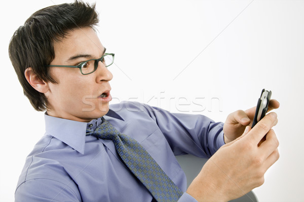 Man surprised at text message. Stock photo © iofoto