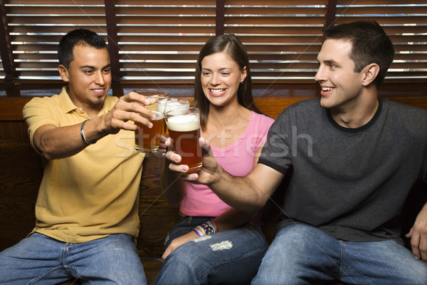 Three Friends Toasting With Beers Stock photo © iofoto