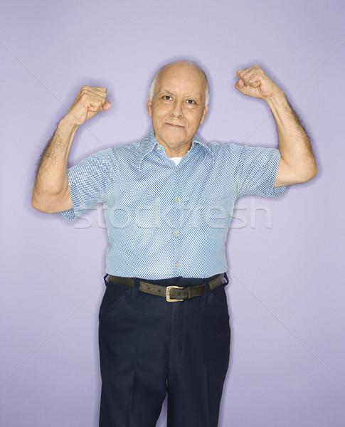 Man flexing muscles. Stock photo © iofoto