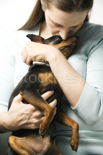 Woman and Miniature Pinscher dog. Stock photo © iofoto