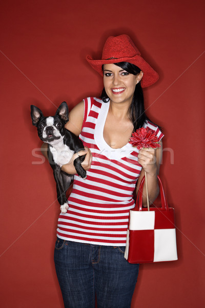 Young woman holding dog. Stock photo © iofoto
