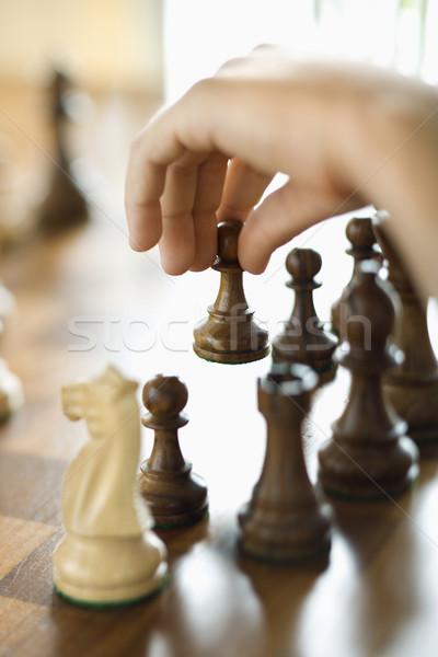 Kéz mozog sakkfigura kaukázusi személy sakk Stock fotó © iofoto