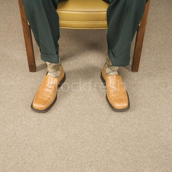Człowiek sukienka buty posiedzenia Zdjęcia stock © iofoto