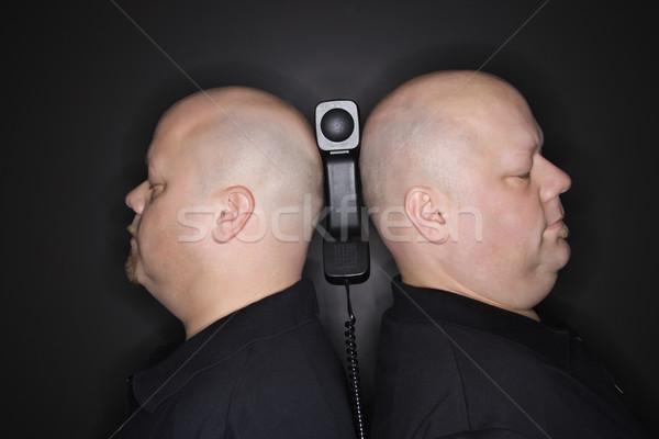 Férfiak telefon kaukázusi felnőtt azonos iker Stock fotó © iofoto