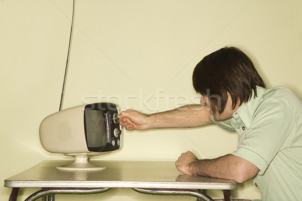 Uomo retro televisione vista laterale seduta Foto d'archivio © iofoto