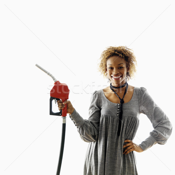 Mujer sonriente mujer gasolina bombear boquilla Foto stock © iofoto