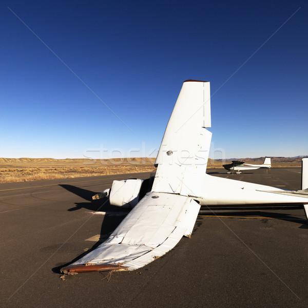 Broken plane on tarmac at airport. Stock photo © iofoto