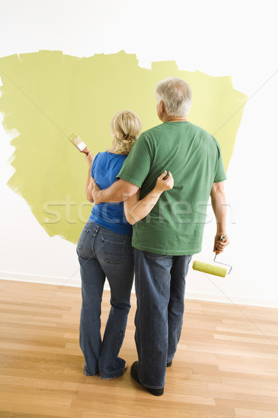 Man and woman observing paint job. Stock photo © iofoto