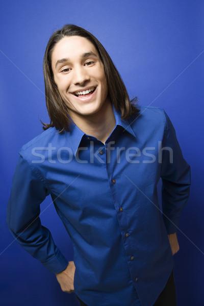 Sonriendo nino retrato adolescente cámara azul Foto stock © iofoto