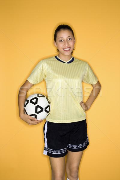 Girl holding soccer ball. Stock photo © iofoto