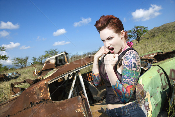 Stock photo: Sexy tattooed woman.