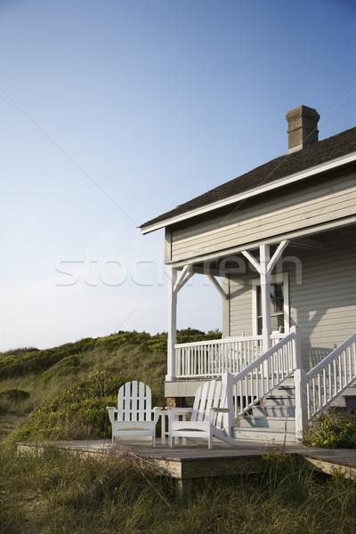 Kust huis veranda dek kaal hoofd Stockfoto © iofoto