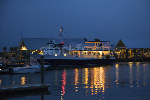 Cruise boat docked in harbor. Stock photo © iofoto