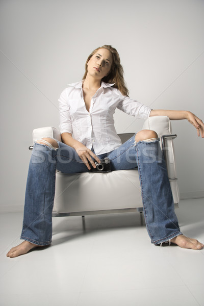 Young Woman Sitting on Chair Stock photo © iofoto