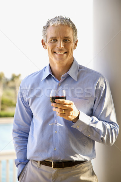 Middle Aged Man Drinking Wine Stock photo © iofoto