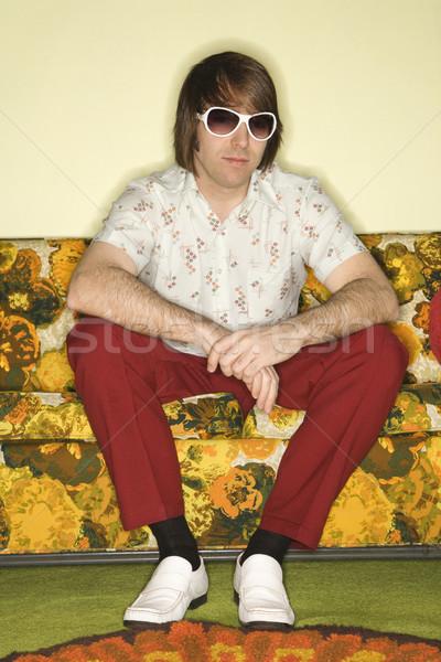 Man sitting on sofa. Stock photo © iofoto