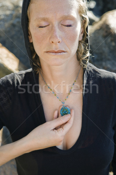 Woman with pendant. Stock photo © iofoto