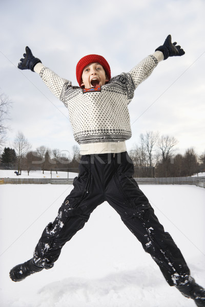 Boy jumping in air. Stock photo © iofoto