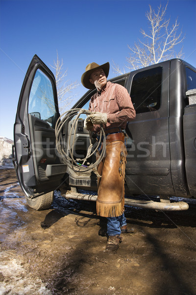 Man Wearing Cowboy Hat With Lariat and Truck Stock photo © iofoto