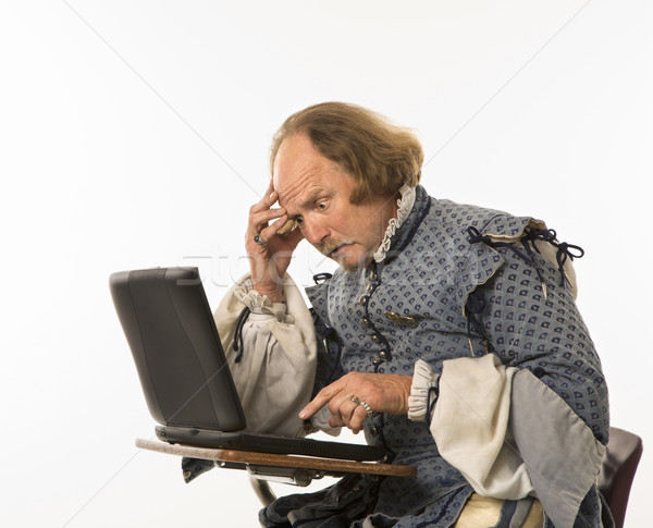 Stock photo: Shakespeare using laptop.