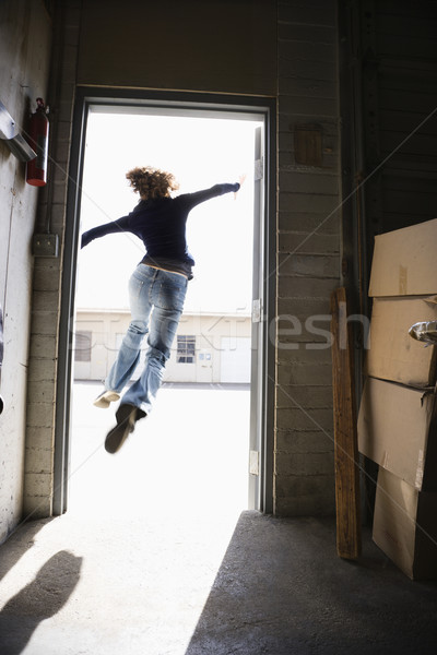 Woman leaping. Stock photo © iofoto